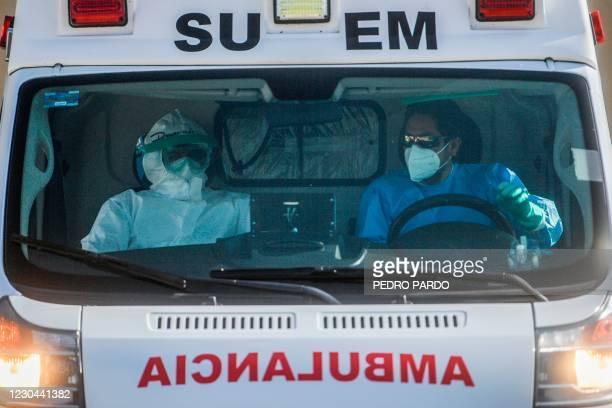Paramedics prepare to transfer a COVID-19 infected patient from the non COVID-19 Temporary Rehabilitation Hospital, in Toluca, Mexico on January 5,...