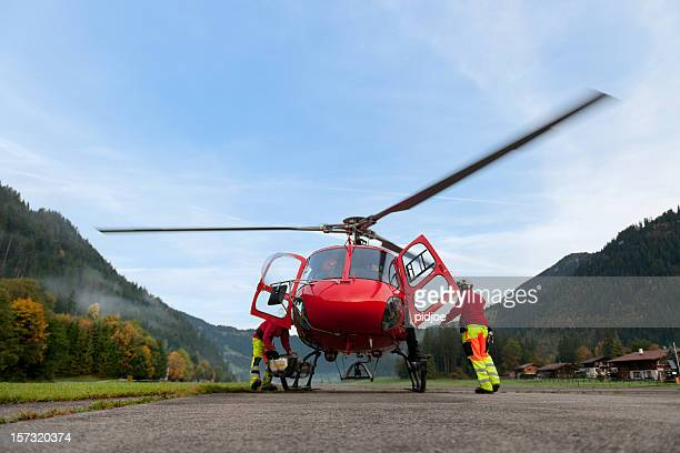 paramedics preparing rescue helicopter for take off - medevac stock photos and pictures