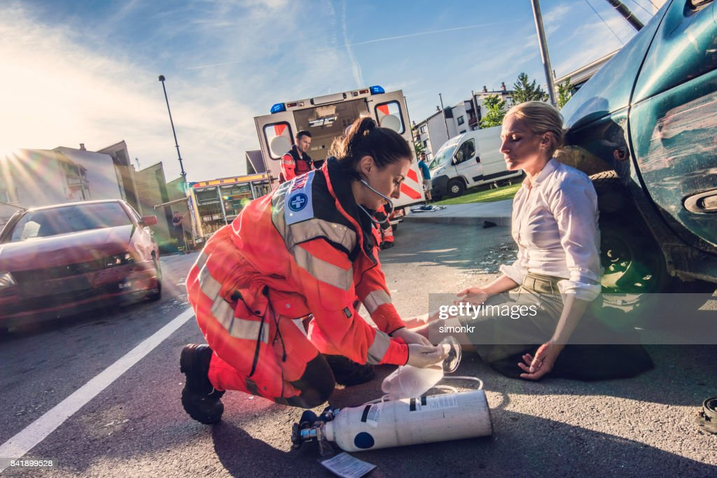 Paramedics providing first aid : Stock Photo