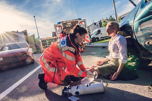 Paramedics providing first aid 841899528