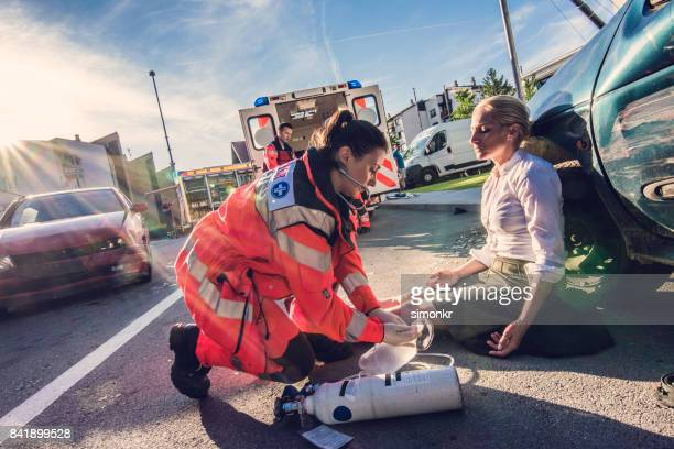 paramedics providing first aid - personal injury stock photos and pictures