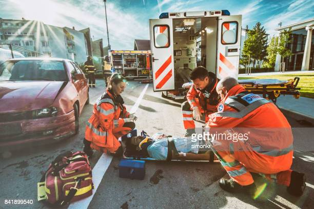 paramedics providing first aid - crash stock pictures, royalty-free photos & images
