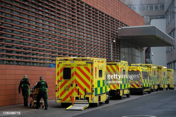 Paramedics push a patient from an ambulance into The Royal London Hospital in London, U.K., on Saturday, Jan. 9, 2021. London Mayor Sadiq...