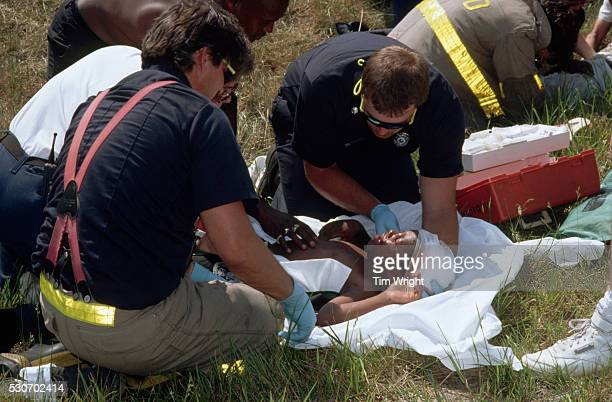 paramedics rescuing child - bloody car accidents stock pictures, royalty-free photos & images