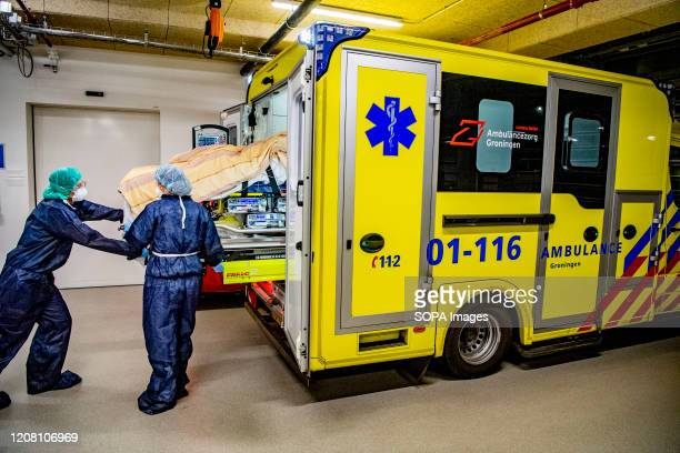 Paramedics stand next to an ambulance ready to transfer a patient to another hospital due to overload amid Coronavirus outbreak The capacity of...