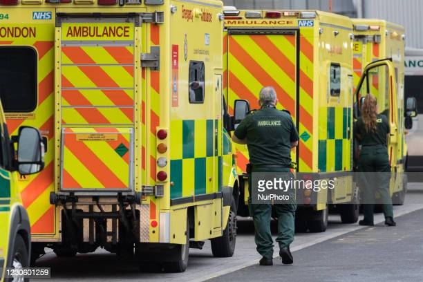 Paramedics stand next to the ambulances outside the emergency department at the Royal London Hospital, on 15 January, 2021 in London, England....