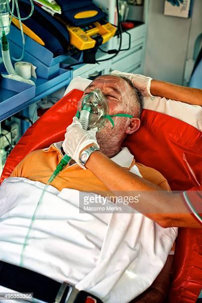 paramedics succor a man with heart attack - myocardium stock photos and pictures