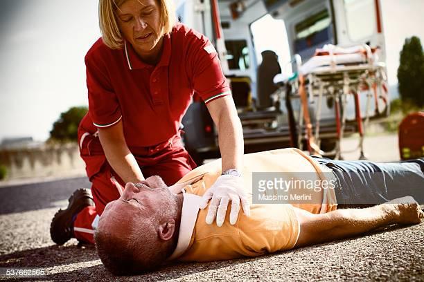 Paramedics succor a man with heart attack
