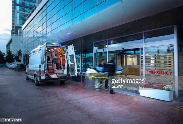 paramedics taking patient on stretcher from ambulance to hospital   speeding ambulance,(blurred motion) - emergencies and disasters stock pictures, royalty-free photos & images