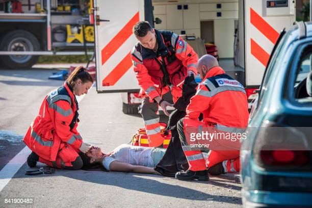 paramedics team conforming - bloody car accidents stock pictures, royalty-free photos & images