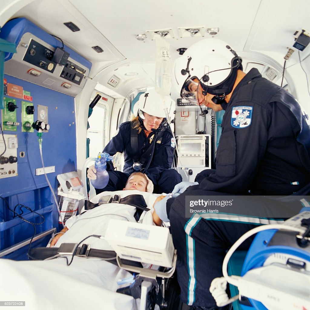 Paramedics Tending to Patient In Helicopter : Stock Photo