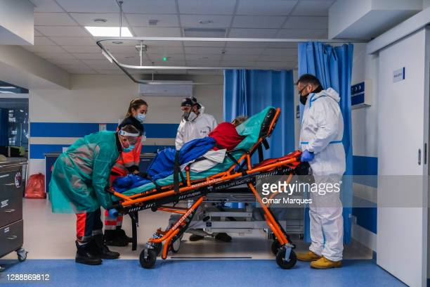 Paramedics transfer a 91 years old Covid-19 patient taken from a nursery house to a bed inside the emergency ward of Bochnia Hospital on December 01,...