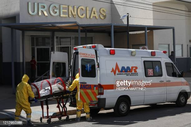 Paramedics transport a patient suspected of being infected with the novel coronavirus, COVID-19, at the General Hospital, in Ciudad Juarez, Mexico on...