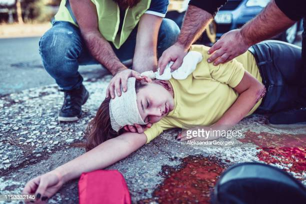 paramedics trying to stop female from bleeding out after accident - gory car accident photos stock pictures, royalty-free photos & images