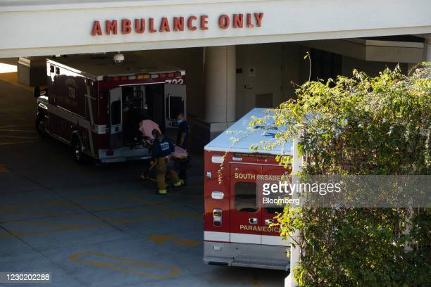 Paramedics wait at the ambulance entrance at Huntington Hospital in Pasadena, California, U.S., on Friday, Dec. 18, 2020. Greater Los Angeles is...