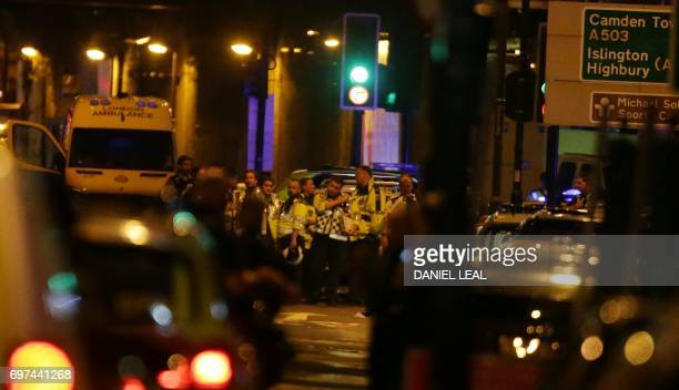 Paramedics wait to assist victims in the Finsbury Park area of north London where a vehichle hit pedestrians on June 19 2017 Several people are...