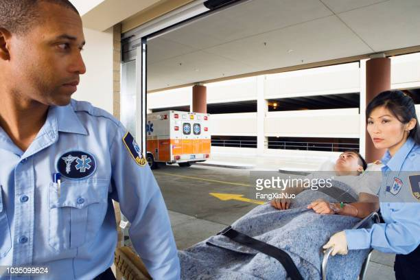 paramedics wheeling man on gurney - drug overdose stock photos and pictures