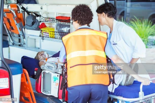 Paramedics wheeling patient out of ambulance