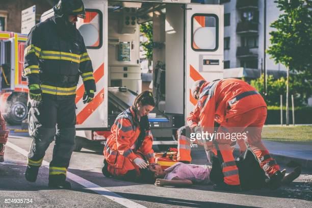 paramedics with car accident victim - of dead people in car accidents stock pictures, royalty-free photos & images