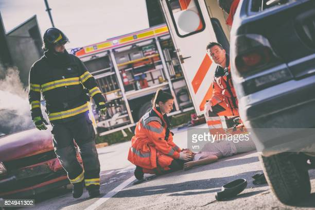 paramedics with car accident victim - dead bodies in car accident photos stock photos and pictures