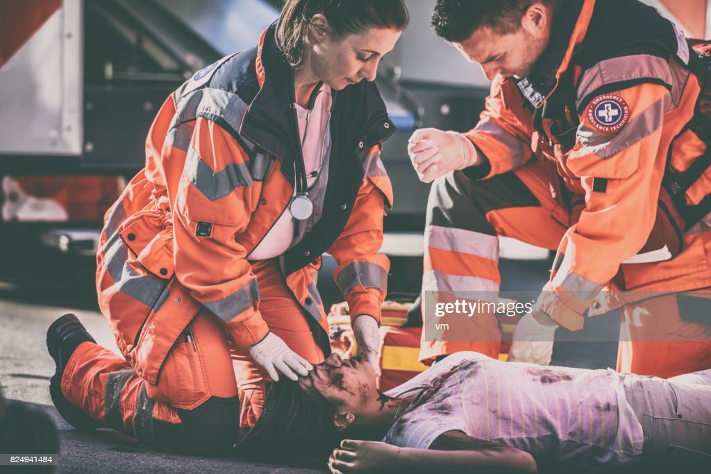 Paramedics with car accident victim : Stock Photo