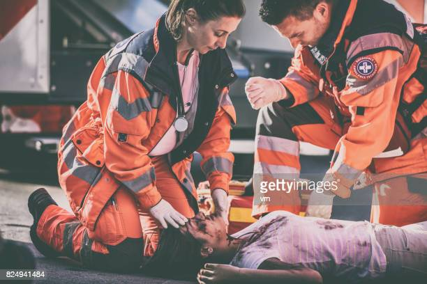 paramedics with car accident victim - bloody car accidents stock pictures, royalty-free photos & images