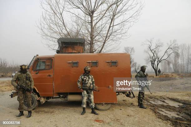 Paramilatary soldiers stands guard near the central Reserve Police Force building which was held by militantsin Lethpora on December 31 2017 in...