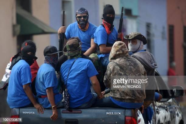 TOPSHOT Paramilitaries are seen on trucks at Monimbo neighborhood in Masaya Nicaragua on July 18 following clashes with antigovernment demonstrators...