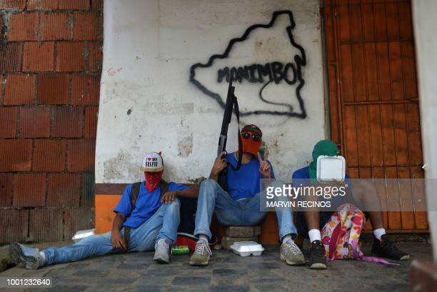 TOPSHOT Paramilitaries rest in Monimbo neighborhood in Masaya Nicaragua on July 18 following clashes with antigovernment demonstrators The head of...