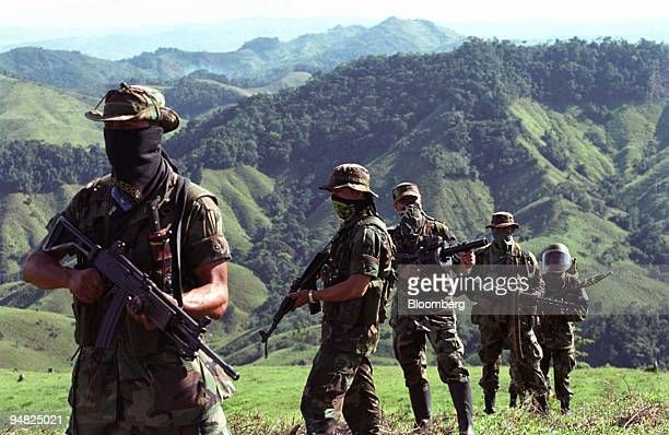 Paramilitary fighters patrol in the mountains of Antioquia Colombia in this 2002 file photo