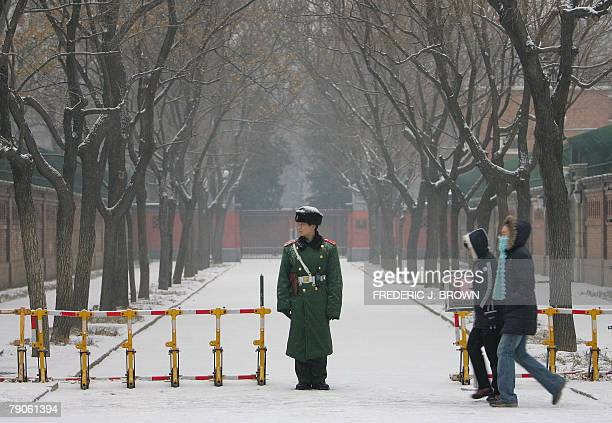 Paramilitary guard mans his post in front of part of the British Embassy under snowfall in Beijing, 17 January 2008. British Prime Minister Gordon...