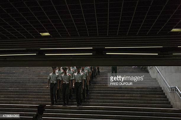 Paramilitary guards walk towards Tiananmen Square in Beijing on June 3 a day ahead of the 26th anniversary of the June 4 1989 crackdown on...