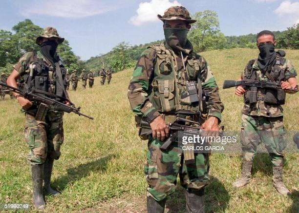 Paramilitary leader of the Colombian United SelfDefense Forces commandant Mauricio trains his troops 29 January in the mountains near Catatumbo...