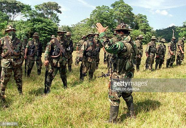 Paramilitary leader of the Colombian United SelfDefense Forces commandant Mauricio gives instructions to his troops 29 January in the mountains near...