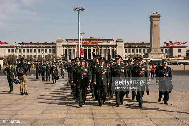 Paramilitary officers arrive at the Second plenary session of the National People's Congress on March 9 2016 in Beijing China The 12th National...