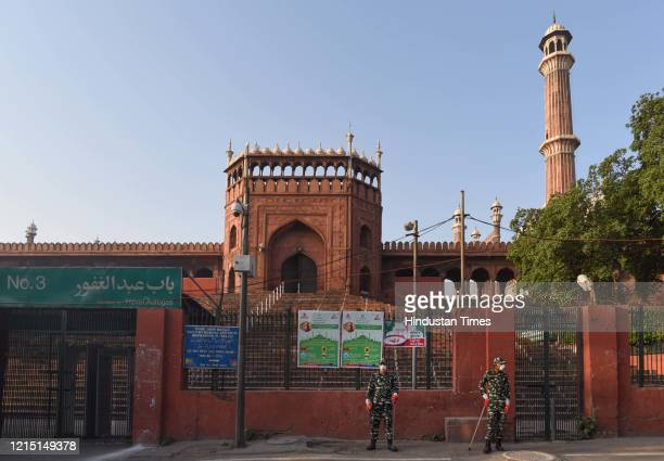 Paramilitary personnel on guard at Jama Masjid with people advised to offer prayers at home on Eid-ul-Fitr during lockdown against coronavirus on May...