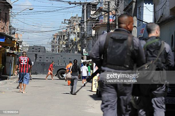 Paramilitary police commandos with an armoured car secure the perimeter during the visit of British Prime Minister David Cameron to the Complexo da...