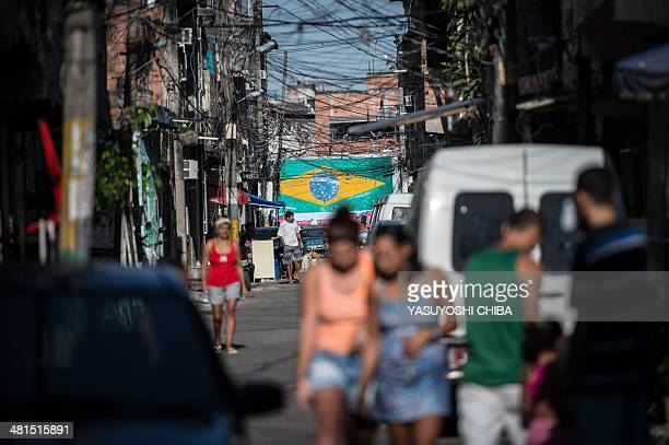 PM paramilitary police CORE elite unit personnel patrol during the occupation of the Favela da Mare shantytown complex in Rio de Janeiro Brazil on...