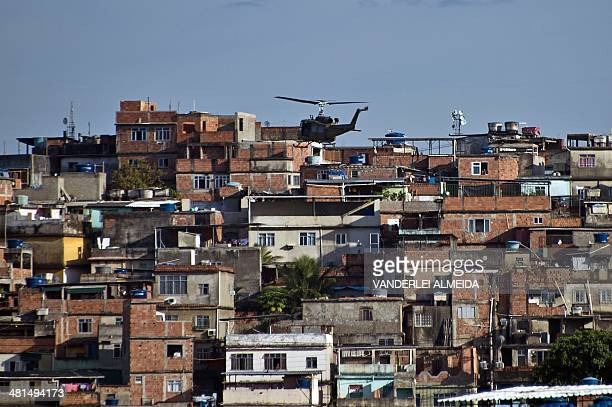 A PM paramilitary police helicopter overflies the Favela da Mare shantytown complex a drugtrafficking stronghold and considered one of the most...