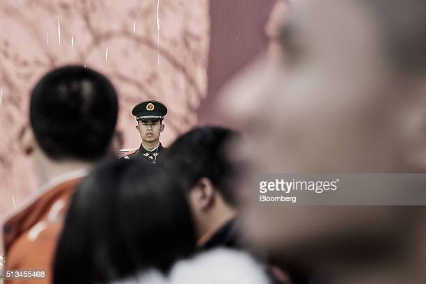 A paramilitary police officer stands guard at the Tiananmen Gate in Beijing China on Wednesday March 2 2016 Obscured by the focus on the accuracy of...