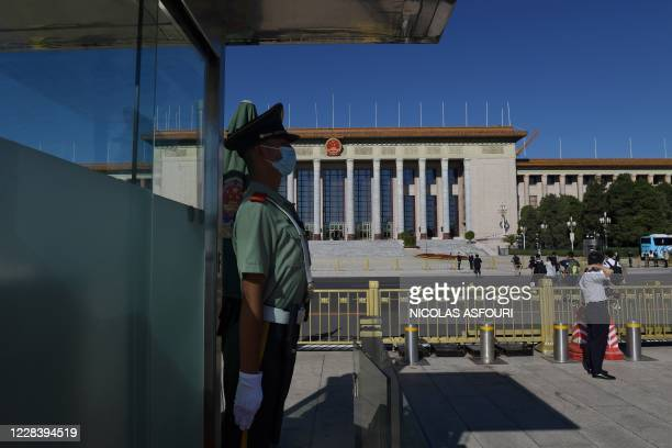 Paramilitary police officer stands guard in Tiananmen Square, opposite the Great Hall of the People ahead of a ceremony hosted by Chinese President...