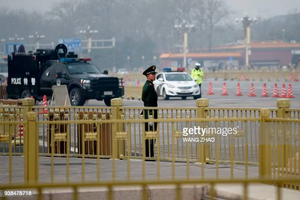 A paramilitary police officer stands guard near Tiananmen Square in Beijing on March 27 2018 Speculation intensified on March 27 2018 that North...