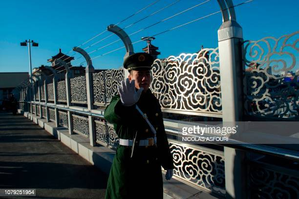 A paramilitary police officer stands guard outside the Beijing Railway Station in Beijing on January 8 where the private train of North Korean leader...