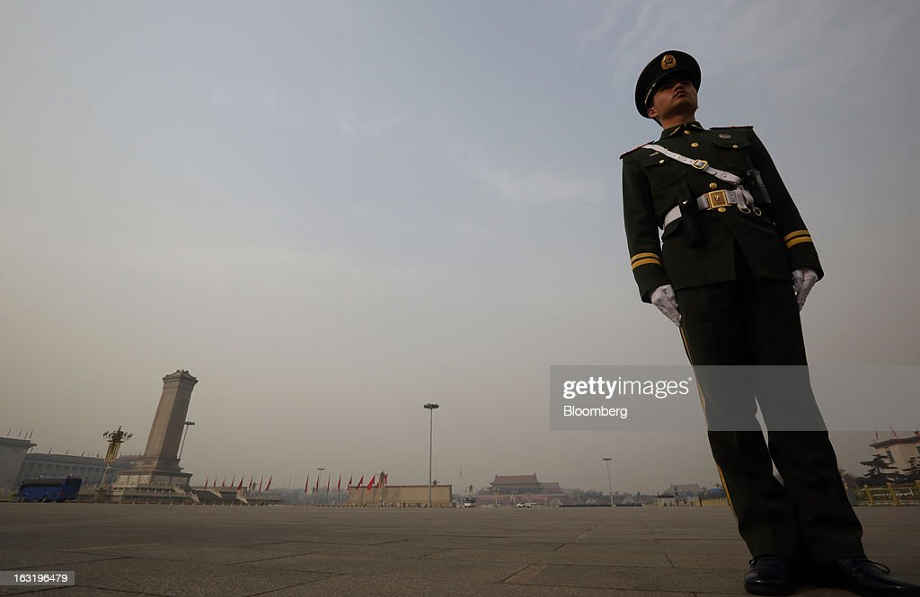 A paramilitary police officer stands guard outside Tiananmen Square before it is opened to the public in Beijing, China, on Wednesday, March 6, 2013. China maintained its economic-growth target at 7.5 percent for 2013 while setting a lower inflation goal of 3.5 percent, setting up a challenge for new leaders to keep prices in check without harming expansion. Photographer: Tomohiro Ohsumi/Bloomberg via Getty Images