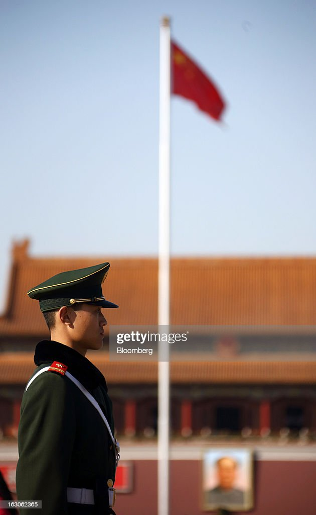 A paramilitary police officer stands guards in front of Tiananmen Gate in Beijing, China, on Monday, March 4, 2013. Premier Wen Jiabao will this week formally announce this year's economic targets when he delivers his final work report to the National People's Congress, which begins on March 5. Photographer: Tomohiro Ohsumi/Bloomberg via Getty Images