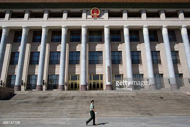 A paramilitary police officer walks past the Great Hall of the People in Beijing China on Monday Sept 8 2014 China is scheduled to release figures on...