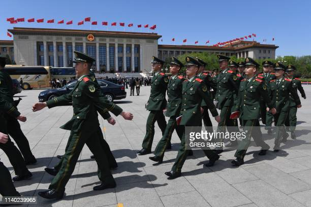Paramilitary police officers march in Tiananmen Square after attending a ceremony marking the centennial of the May Fourth Movement a landmark...