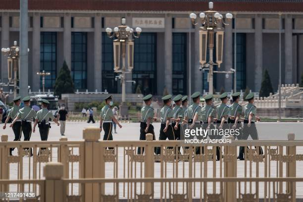 TOPSHOT Paramilitary police officers march on Tiananmen Square in Beijing on June 4 2020 This year marks 31 years since the Tiananmen crackdown on...