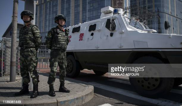Paramilitary police officers secure the entrance of the Belt and Road Forum venue in Beijing on April 26 2019 Chinese President Xi Jinping sought to...