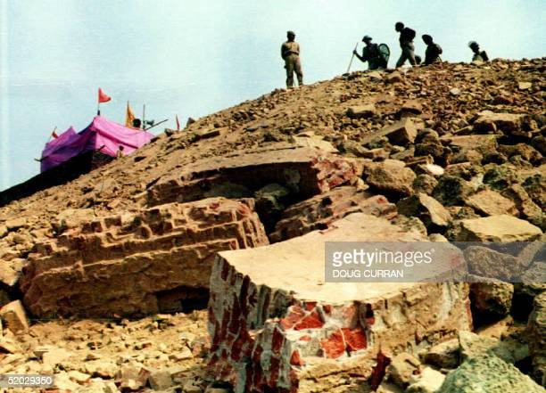 Paramilitary police position themselves on a hill overlooking the ruins of the 16th century Babri mosque 08 December 1992 in Ayodhya India Behind is...